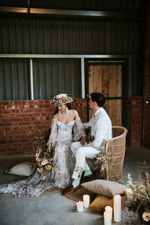 Bride and Groom Sitting on Peacock Chairs