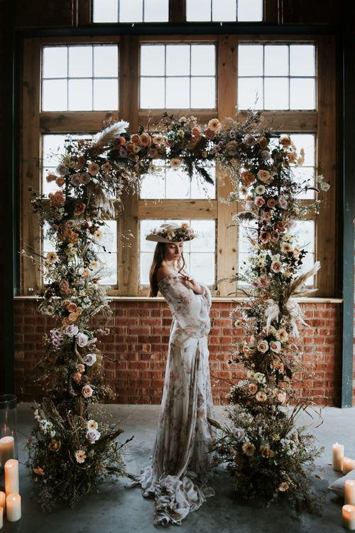 Bohemian Bride in front of Dried Flowers Floral Arch