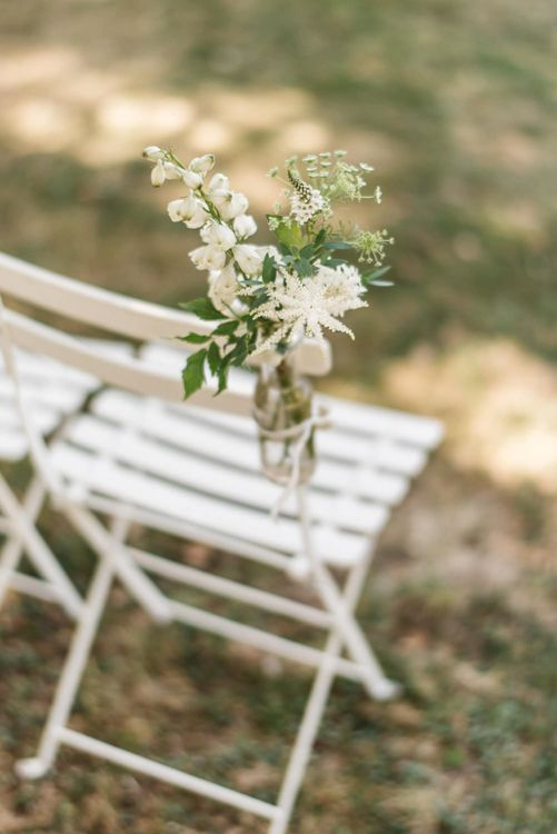 White and Green Flower Stem in Bottle as Aisle Chair Flowers
