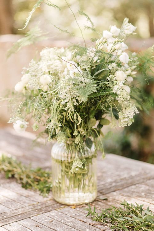 White and Green Wedding Flowers in Glass Vase