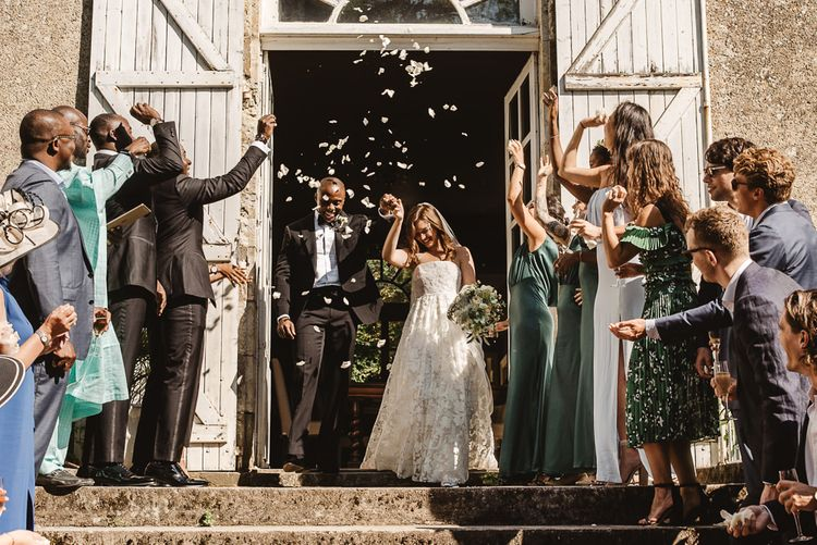 Confetti Moment with Bride in Jesus Peiro Wedding Dress and Groom in Ralph Lauren Purple Label Tuxedo