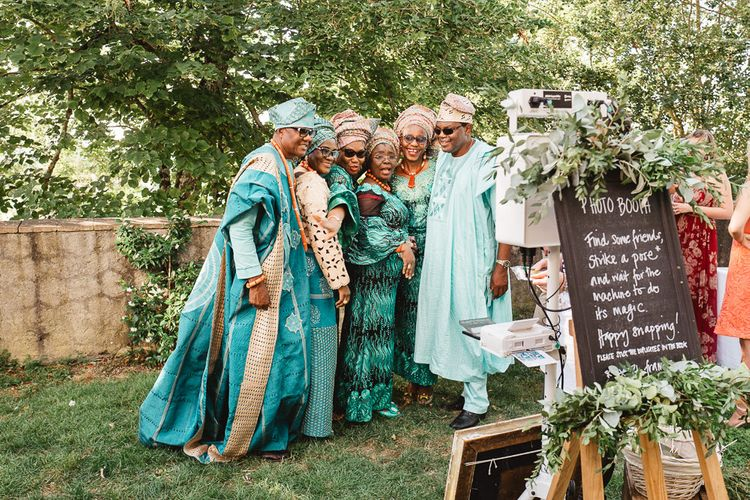 Ghana and Nigerian Wedding Guests in Traditional Attire Posing at the Photo Booth