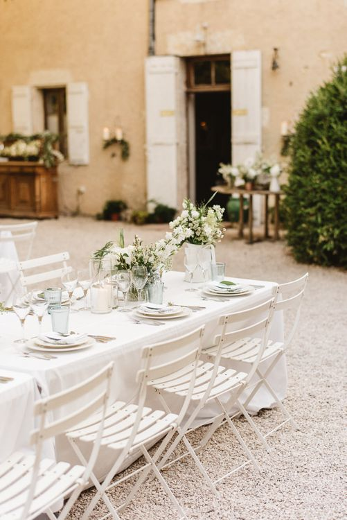 White Flowers in Vases at Outdoor Reception at Chateau de Lartigolle in France