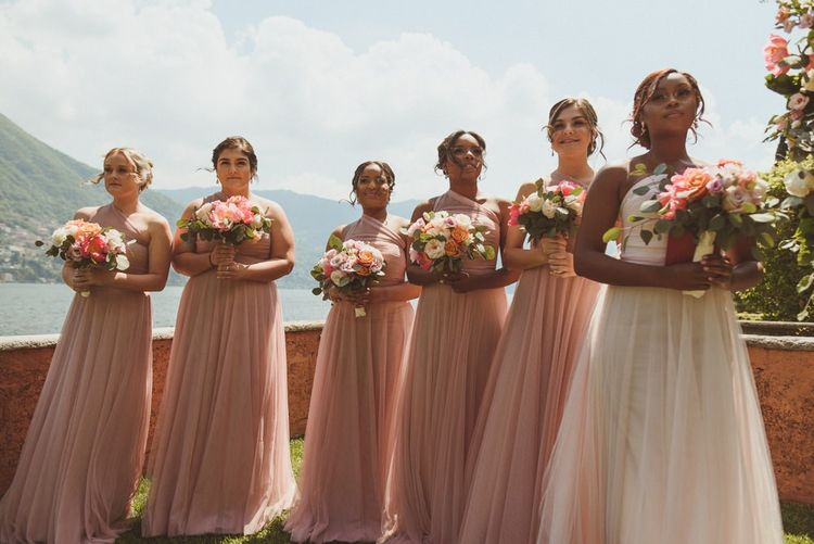 Bridal party in pink and white chiffon dresses