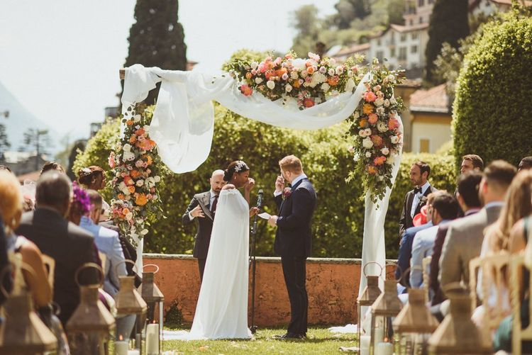 Bride and groom exchanging vows at Lake Como wedding