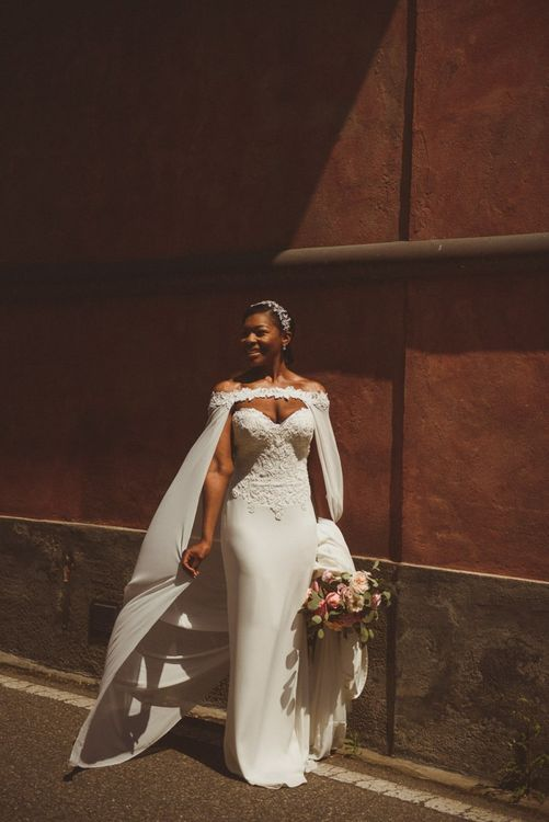 Bride in Justin Alexander bridal cape for Lake Como wedding