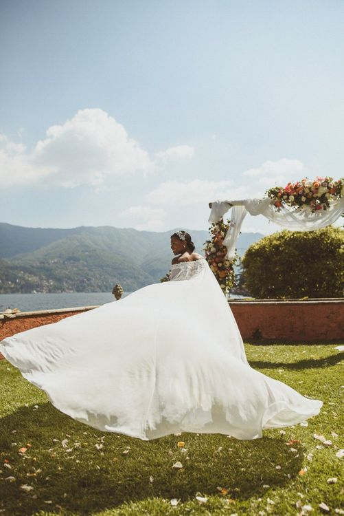 Bride twirling her wedding cape