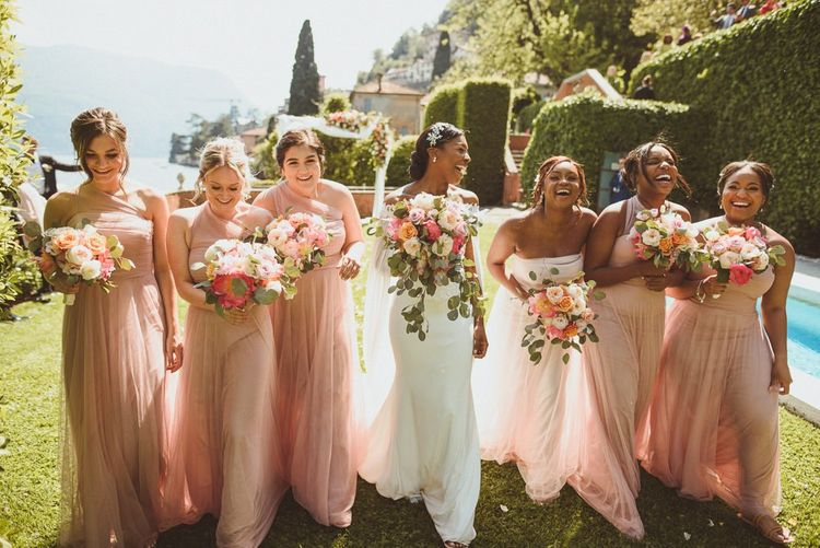 Bridal party portrait with bridesmaids in pink chiffon dresses