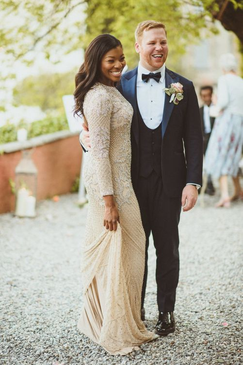 Bride in embellished gold evening wedding dress