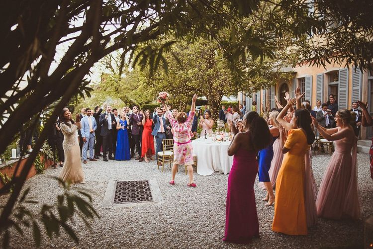 Bouquet toss at Lake Como wedding