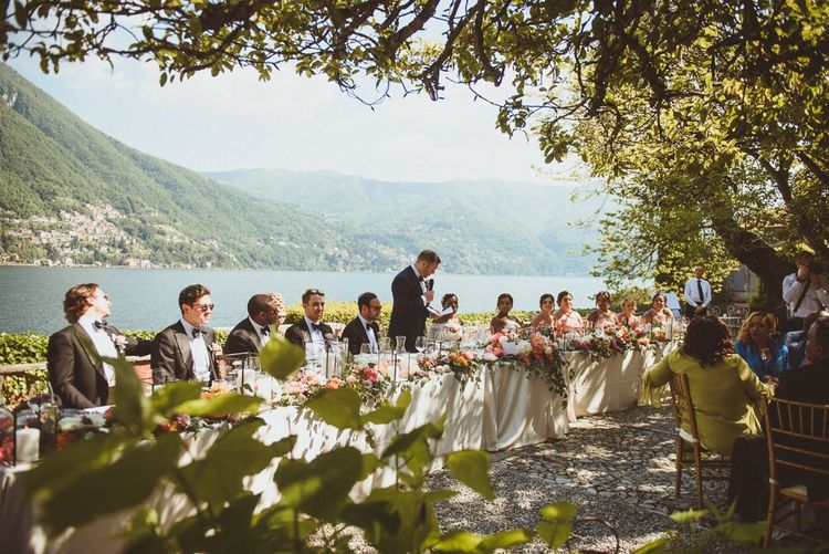 Groom delivering his speech at the top table with views of Lake Como