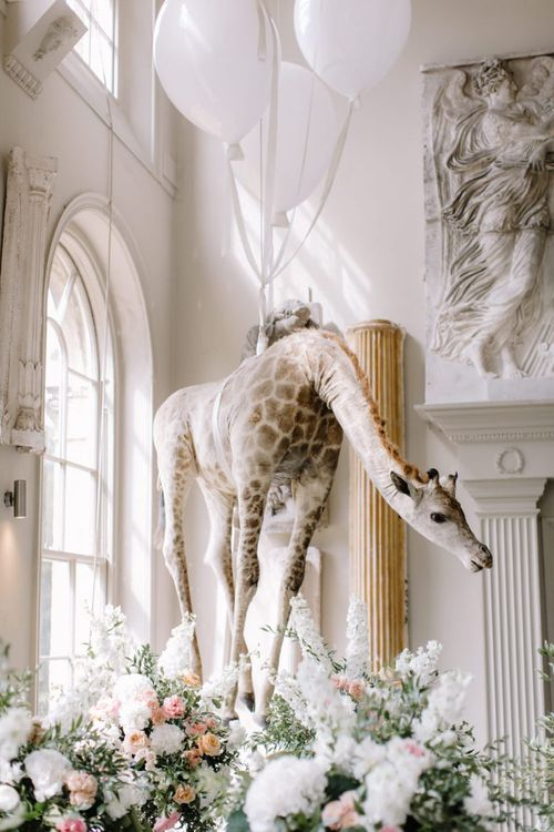 Hanging giraffe at Aynhoe Park wedding venue