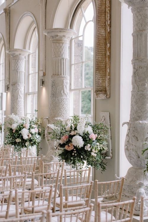 Aisle wedding flowers at Aynhoe Park wedding ceremony