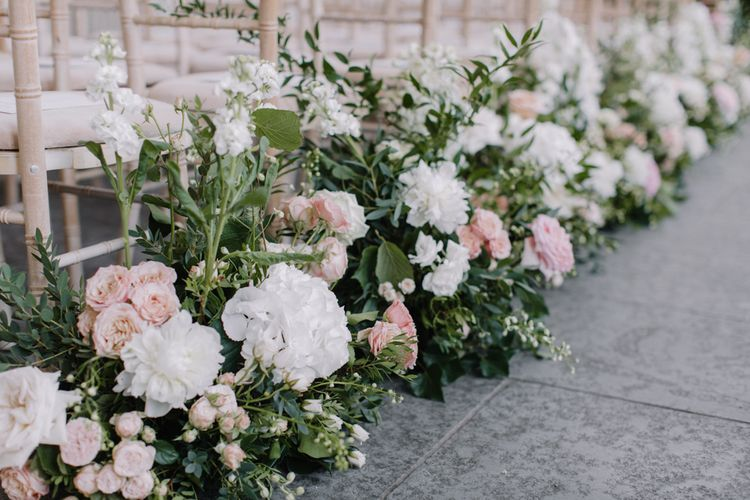 Pink and white aisle wedding flowers for Aynhoe Park ceremony