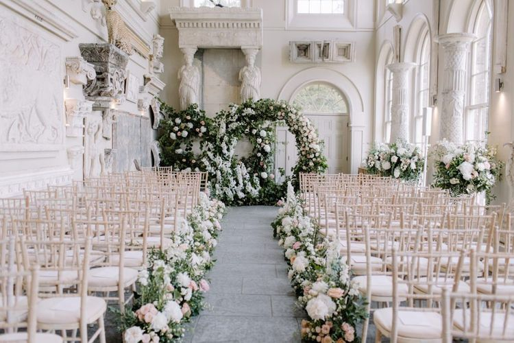 Aisle and altar wedding flowers at Aynhoe Park Orangery