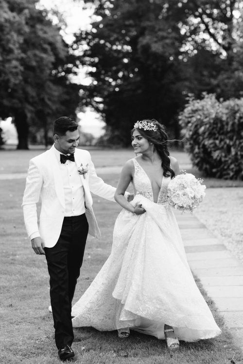 Black and white bride and groom portrait with bride in Berta Bridal gown
