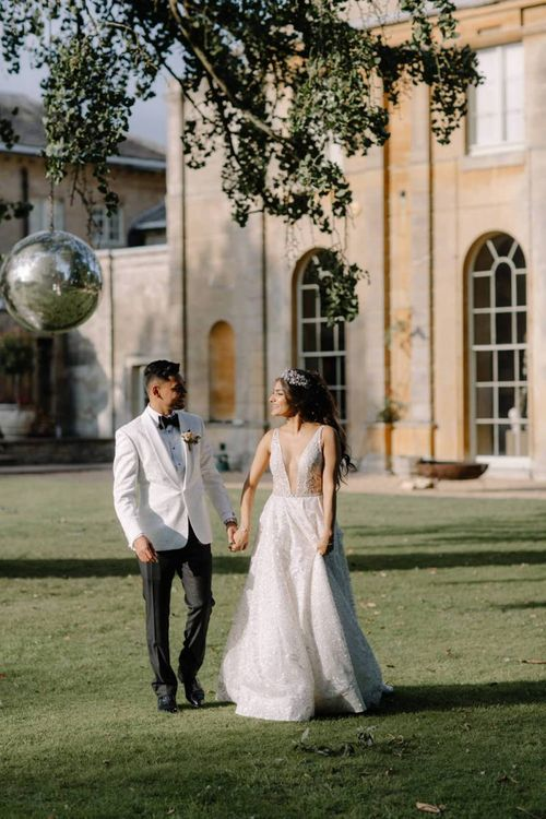 Bride and groom portrait by Rebecca Goddard Photography with bride in Berta Bridal wedding dress