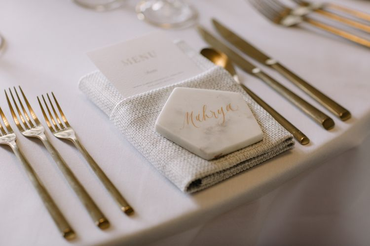 Marble name place setting with gold font for luxury wedding at Aynhoe Park with Berta Bridal gown