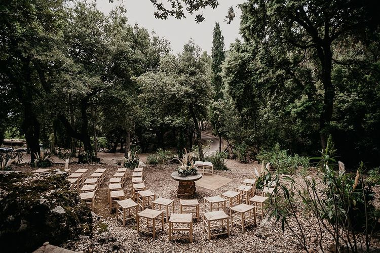 Forest neutral decor wedding ceremony with beige wedding suit
