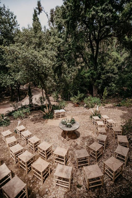 Outdoor wedding ceremony with neutral decor and pampas grass