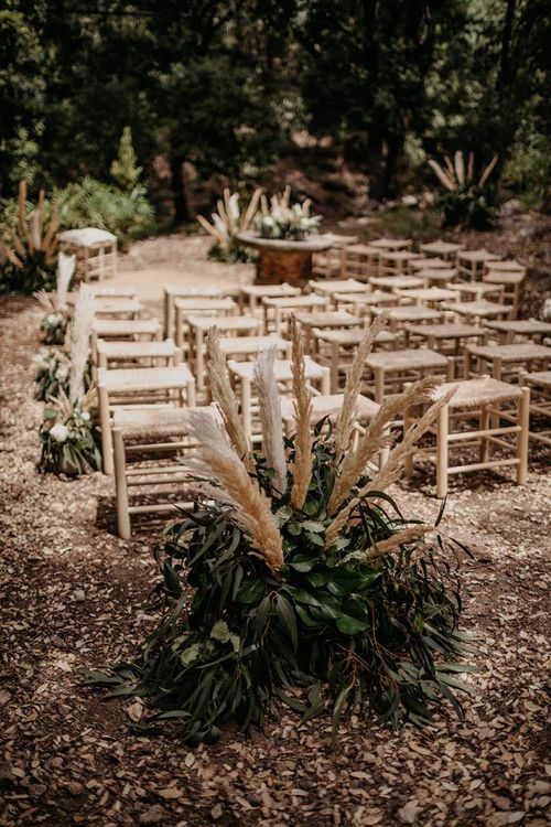 Forest wedding ceremony with natural decor