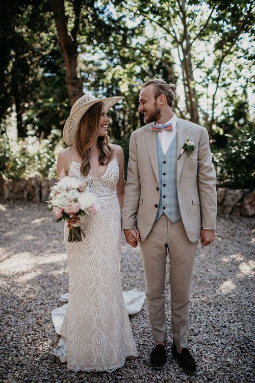 Beige wedding suit with blue waistcoat and bowtie