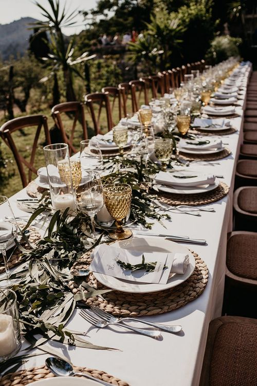 Foliage decor for earthy wedding with beige wedding suit and straw hats