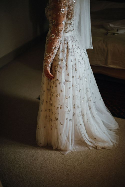 Bride in Bead Embellished Needle & Thread Gown with Cascading Tulle Skirt and Semi-Sheer Sleeves