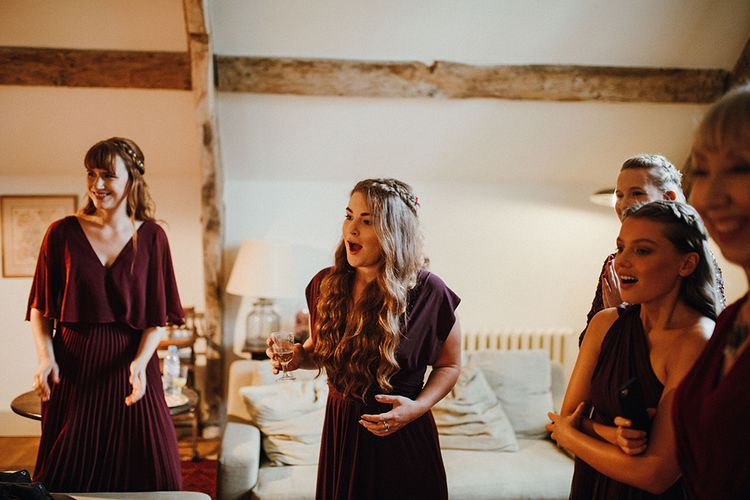 Bridesmaids in Mismatched Maroon Dresses from High Street | Mariachi Band and Persian Rug Aisle for Autumn Wedding | Leah Lombardi Weddings