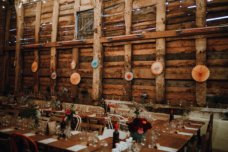 Wooden Banquet Tables | Mismatched Rustic Chairs | Paper Fans | Kraft Place Settings | Pink, Orange and Maroon Flowers for Tables | Mariachi Band and Persian Rug Aisle for Autumn Wedding | Leah Lombardi Weddings