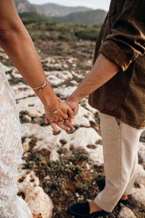 Bride and groom holding hands at intimate wedding