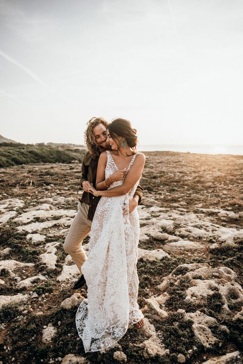 Bride and groom embracing at portrait session on the beach for Mallorca elopement
