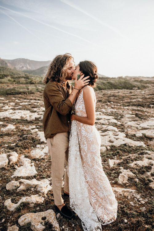 Bride and groom kissing at intimate Mallorca elopement