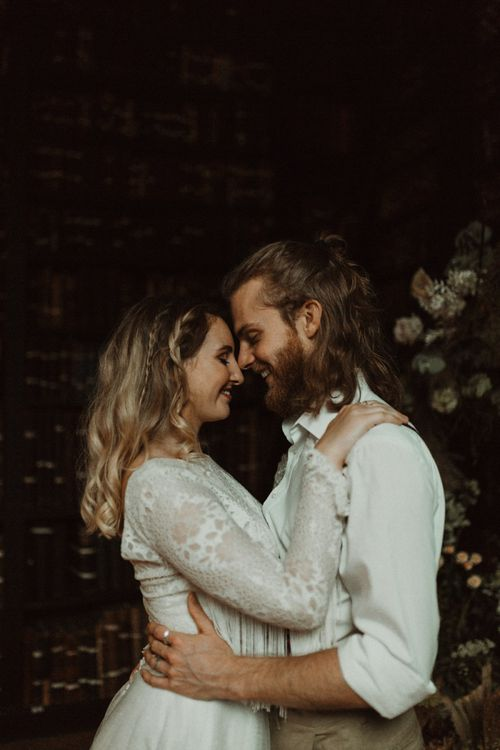 Bride in Separates and Groom in Chinos and Braces Looking into Each Others Eyes