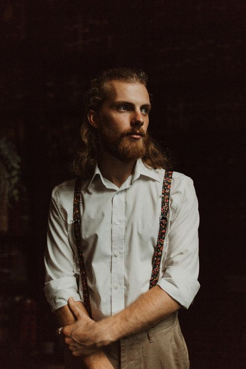 Boho Groom in White Shirt and Floral Braces