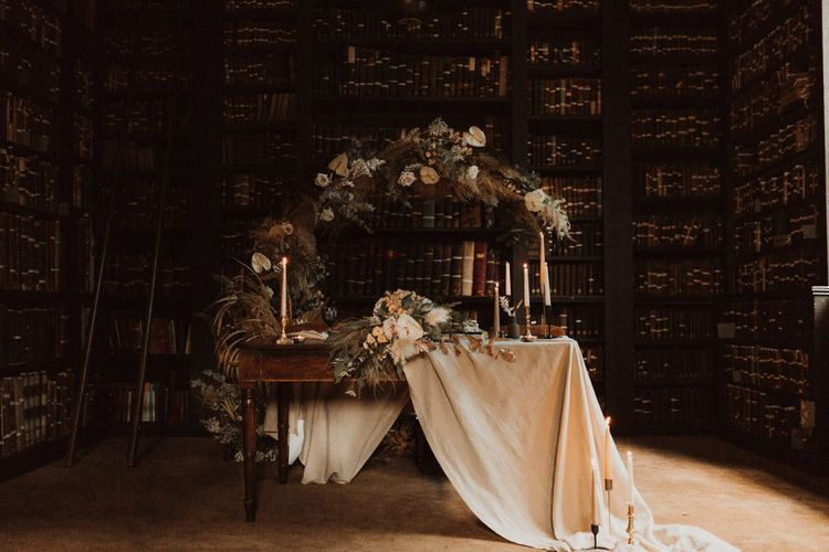 Sweetheart Table in Portico Library with Dried Flower Moon Gate  Backdrop
