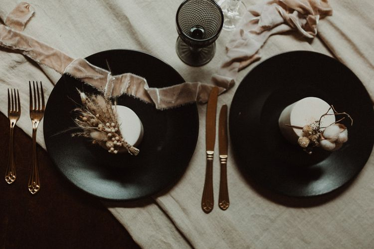 Black Tableware with Gold Cutlery and Linen Table Runner