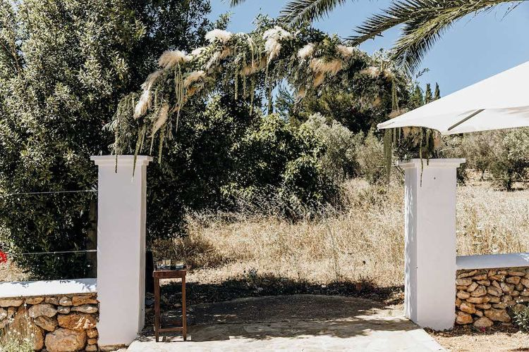 Pampas grass and foliage arch