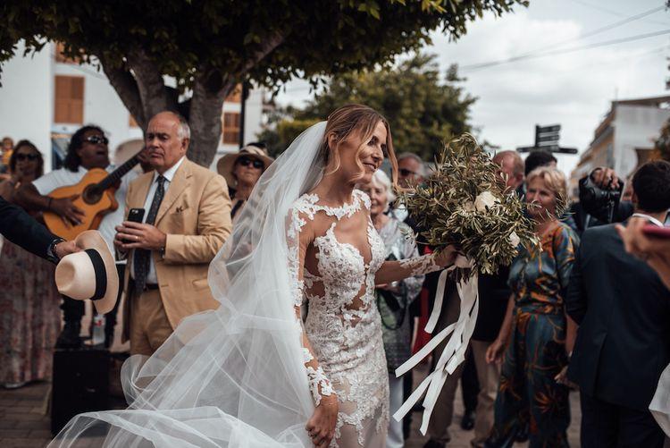 Bride in sheer lace wedding dress