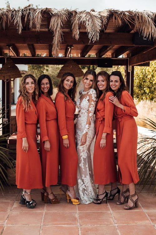 Bridesmaids in orange wrap dress