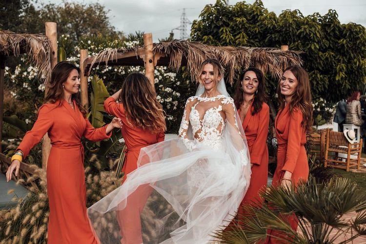 bridal party portrait with bridesmaids in orange dresses