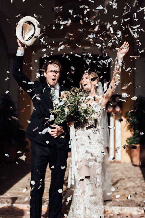 Bride and groom confetti exit at Ibiza wedding ceremony