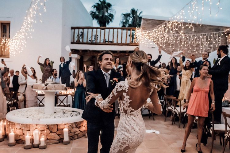 Bride and groom first dance at outdoor evening reception