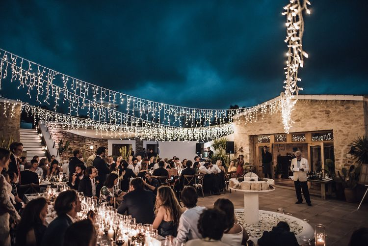 Outdoor wedding reception with string lights wedding decor