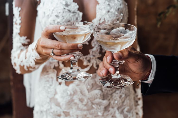 Bride and groom champagne toast with coupe glasses