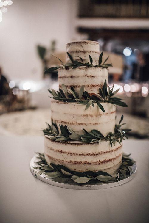 Semi naked wedding cake with olive leaves decor