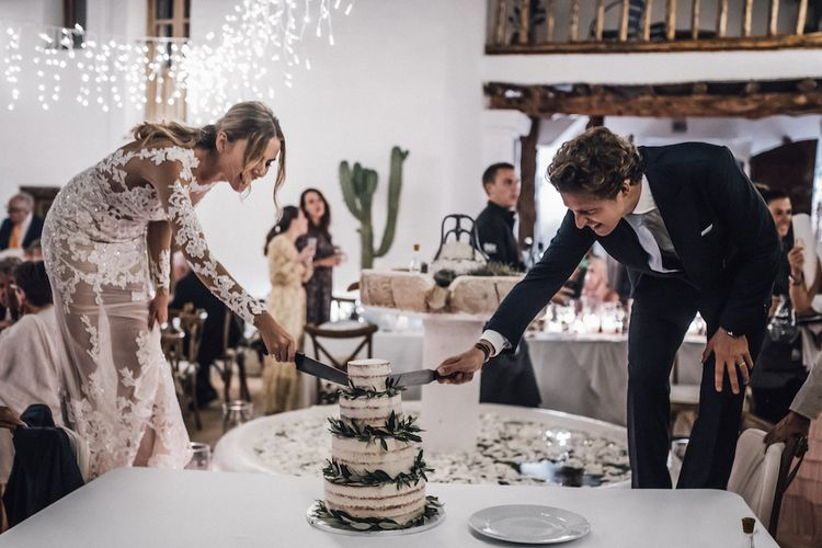 Bride and groom cutting the semi naked wedding cake