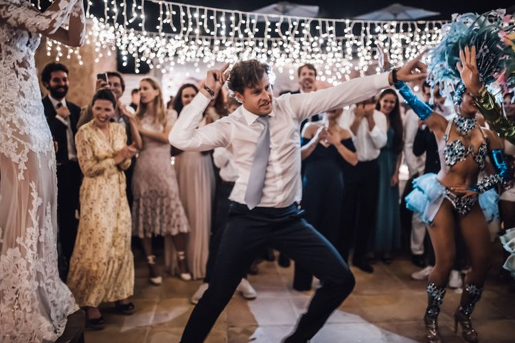 Groom dancing at the evening reception