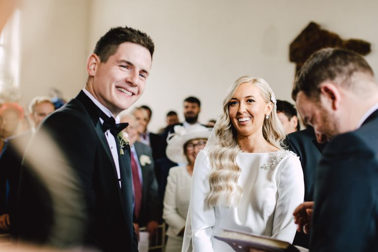 Bride and groom tie the knot at black tie autumn celebration in Wales