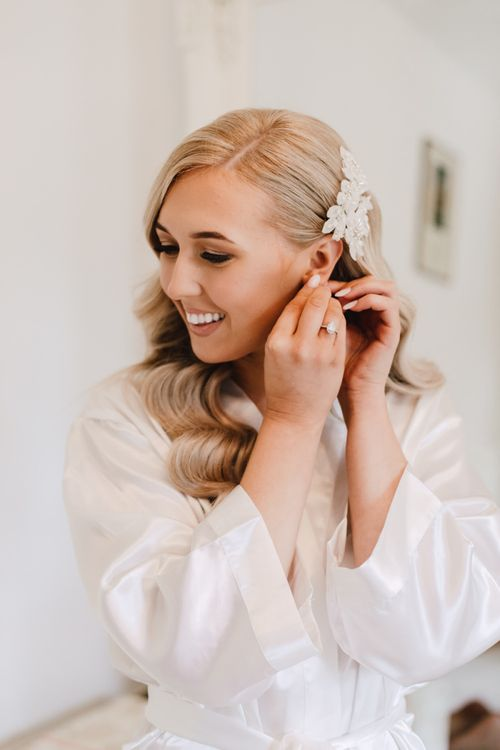 Bride getting ready for reception at Wales wedding venue wearing hair accessory